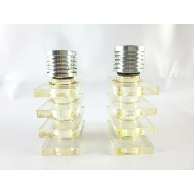 "Pair of Art Deco Lucite Perfume Bottles Each bottle measures approx 3 1/4"" tall x 2 1/4"" wide x 1 1/4"" deep Chrome caps..."