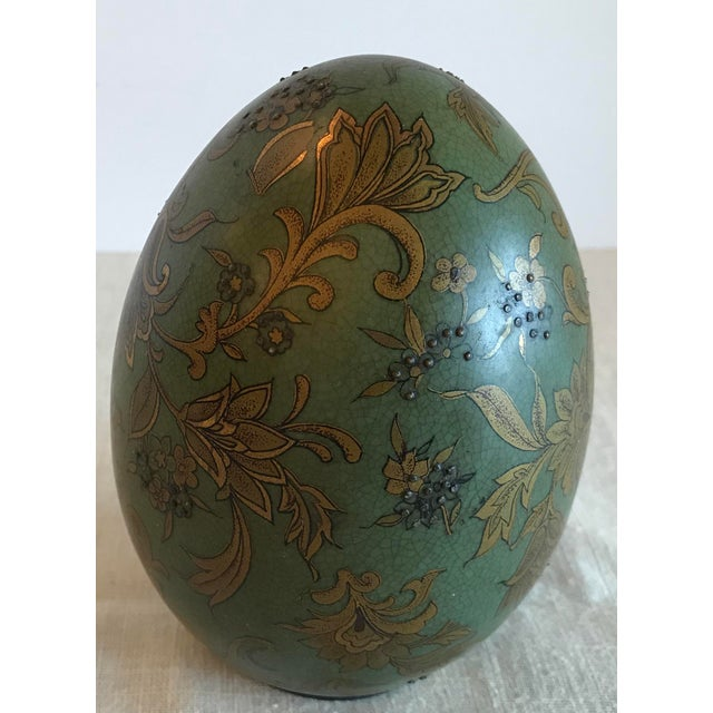 Nice egg for your collection in a beautiful green with gold floral pattern. Has raised detail and would look great in a...