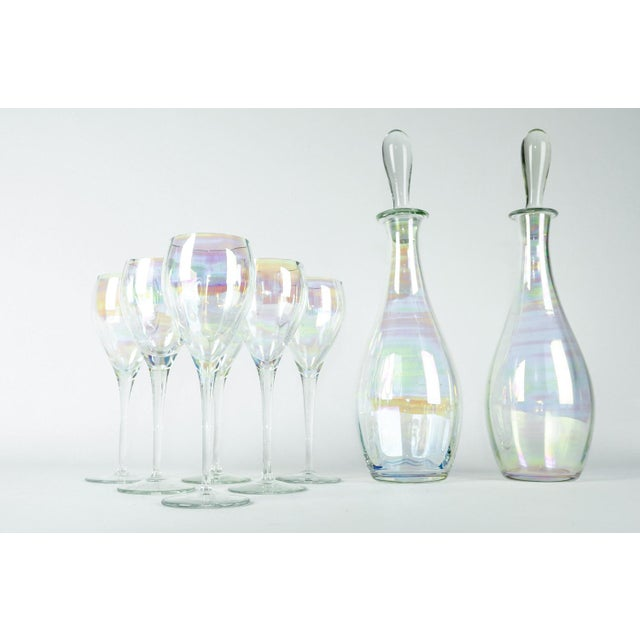 Italian Murano Iridescent crystal decanter set with wine glasses. The set is in excellent condition. All together two...