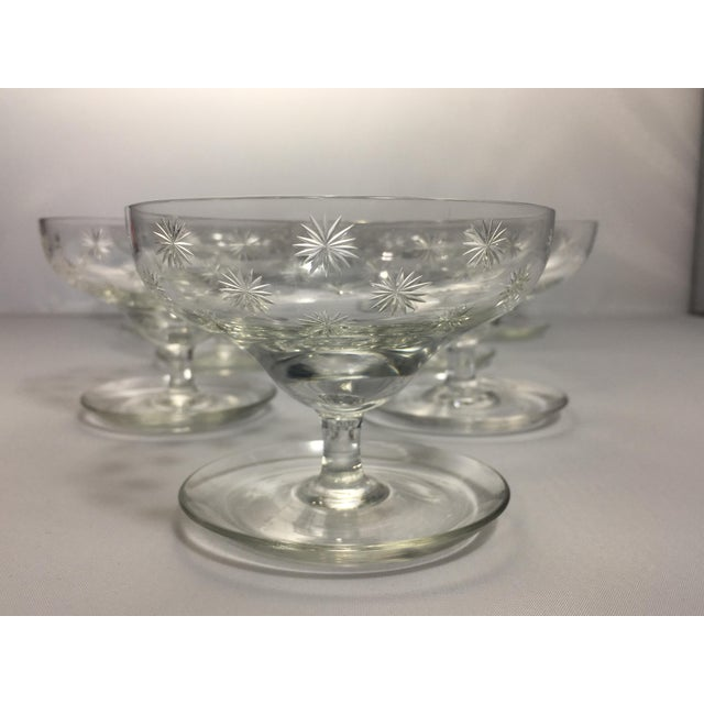 Retro look, mid century crystal shrimp cocktail style glassware with a cut star pattern and unique base. Would be perfect...