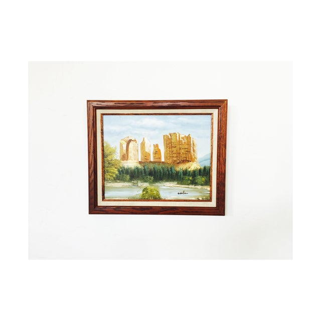 An original vintage oil painting of mesas in a Southwestern landscape on canvas in a wood frame. Lovely colors and...