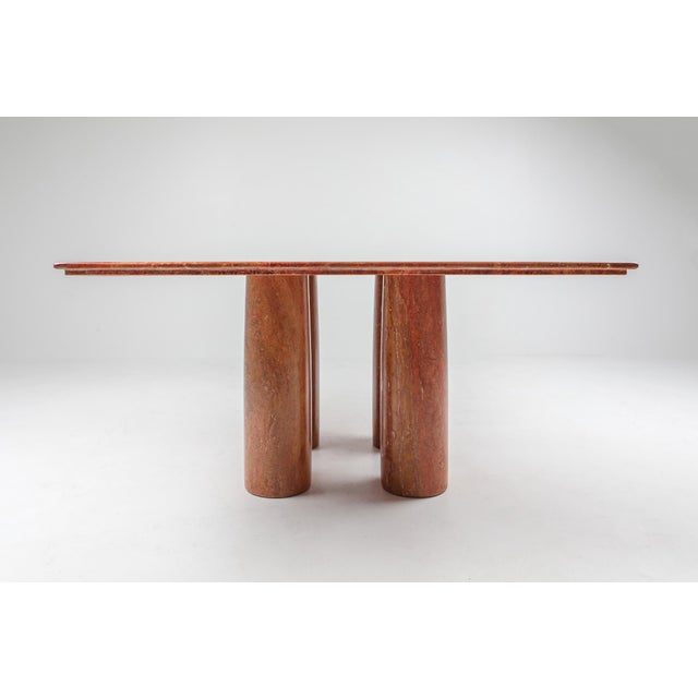 Mario Bellini for Cassina, 'Il Colonato' table, red travertine, Italy, 1970s. For this series of tables, Bellini was...