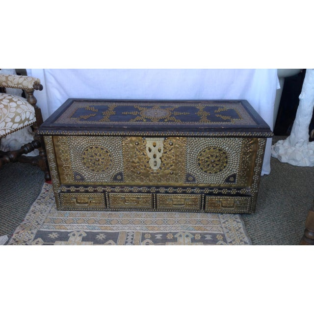 Fashioned with elaborate applied brass work, nail head design as well as brass handles - the trunk is also designed with...