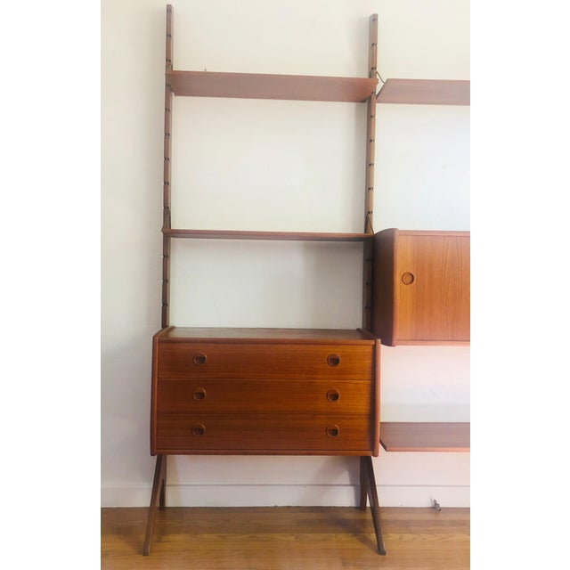 A mid century teak free-standing wall unit designed by Jon Texmon for Blindheim Møbelfabrikk and produced in Norway in the...