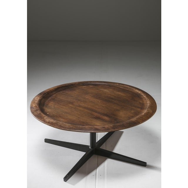 Revolving side table by Gianni Moscatelli for Forma Nova. Large plywood top with bent edges and sleek metal frame.