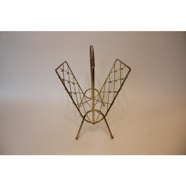 Purchased from a dealer in St. Louis for designer Barry Goralnick's own apartment, this brass magazine stand has a ton of...