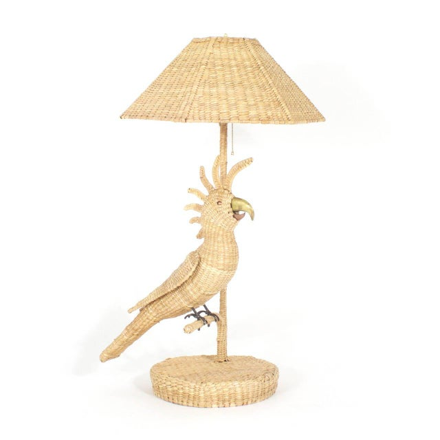 Pair of Mario Torres table lamps depicting cockatoos perched on a branch with brass and copper beaks and copper eyes....