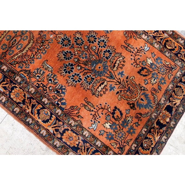 Antique hand knotted Persian Sarouk rug in original good codition. The rug is from the beginning of 20th century in red...