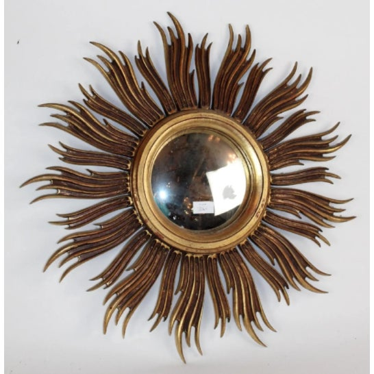 Stylish vintage sunburst wall mirror, with gilt sun rays, and original convex center mirror. This mirror is a timeless...