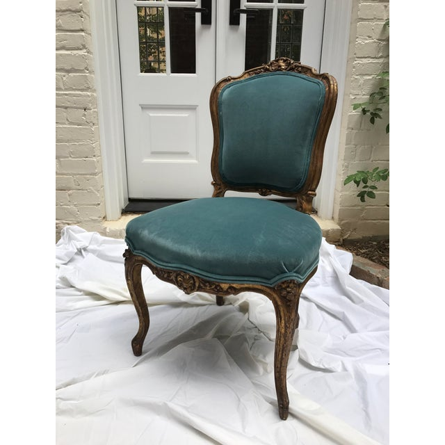 Antique gilt ballroom chair newly upholstered in a Ralph Lauren Home cotton velvet. While upholstered the chair was re-...
