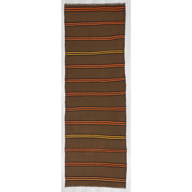 Handwoven striped kilim runner rug from Kars region of Turkey.In very good condition