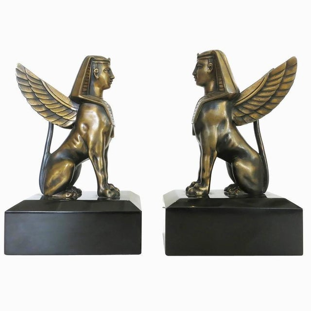 1920s inspired sculpture of sphinx solid bronze on absolute black marble. Could be used as bookends or figurine. Sold in...