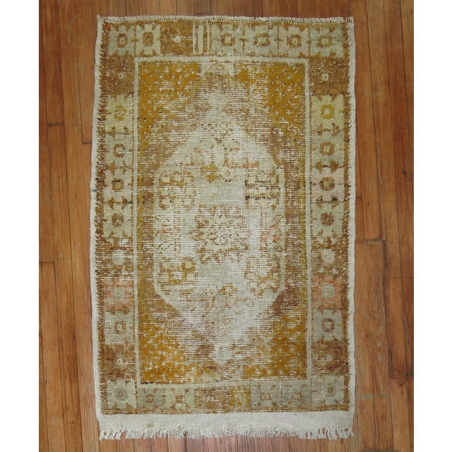Mid 20th century hand-knotted distressed Turkish Anatolian Rug.