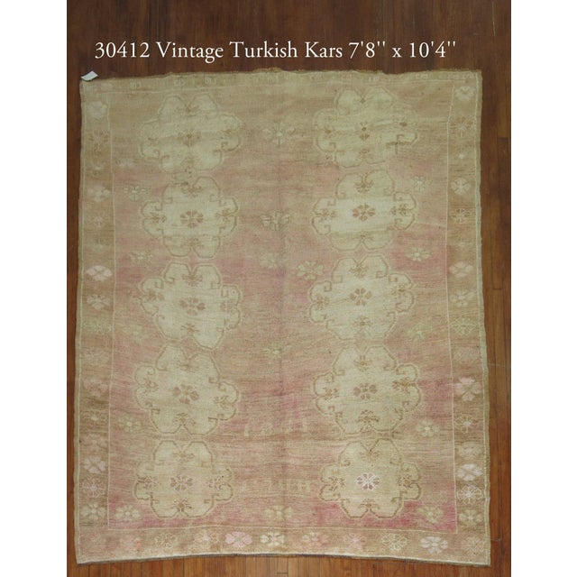 Offered is a mid 20th century Turkish Oushak rug in a soft pink tone. Thick, medium pile throughout with an all-over...