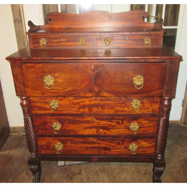Circa 1820 -1840 American Empire crotch mahogany Federal chest of drawers. The chest has wonderful matching hardware . I...