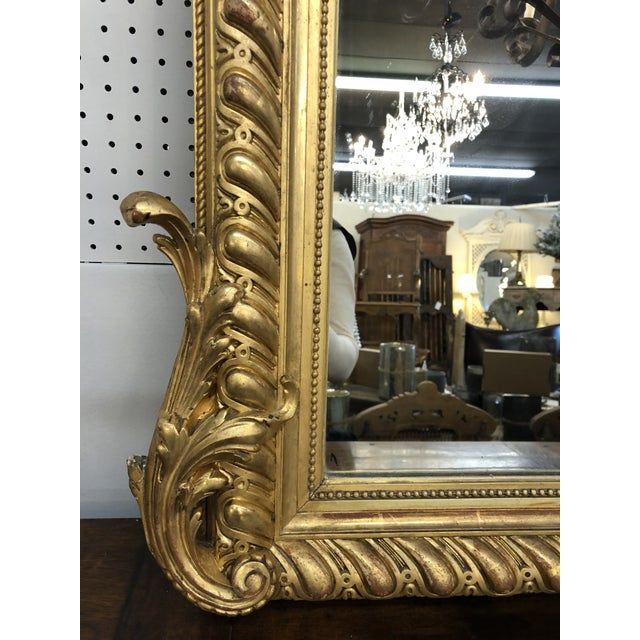 19th C. French Napoleon III gilt mirror. This monumental mirror consists of a focal rocaille shell carving, lattice sides,...