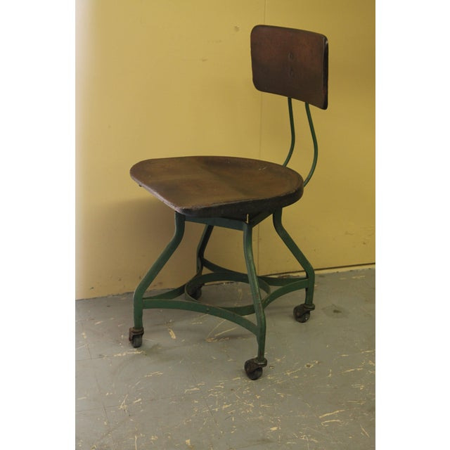 Unusual industrial chair on wheels from The Toledo Metal Furniture Co. The seat is made of a composite material that at...