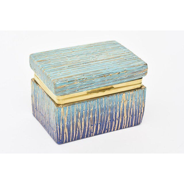 This stunning and well executed Italian Mid-Century Modern Aldo Londi for Bistossi glazed ceramic hinged box with brass...