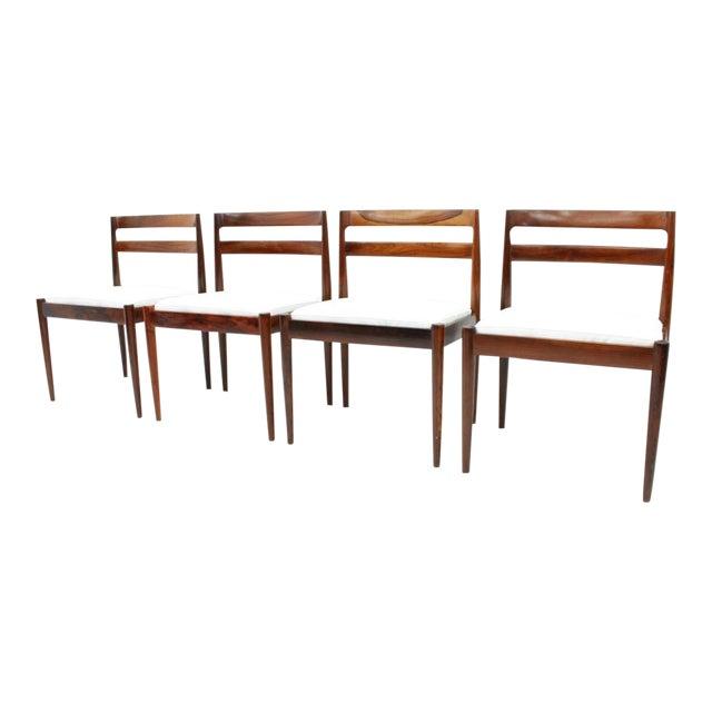 """Kai Kristiansen Dining Chairs """"Universe 301"""" for Magnus Olesen Denmark 1960s For Sale"""