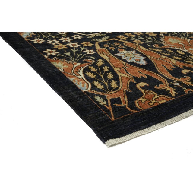 Ziegler hand knotted area rug made in Pakistan. The tradition of hand-knotting rugs has been passed from generation to...