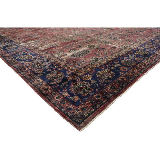 Admired for its timeless style, this distressed antique Persian Kerman rug is celebrated for sophistication and very much...