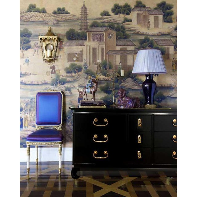 We love this Hollywood Regency, mid-century Chinoiserie dresser by Kent Coffey. Newly refinished in high gloss black with...