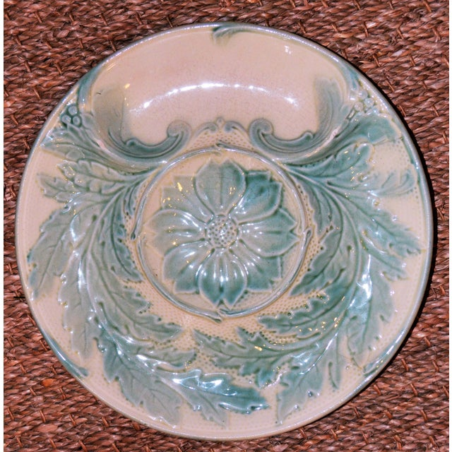 This is a beautiful and rare antique French majolica artichoke plate. This artichoke platter is in a beautiful scenery is...