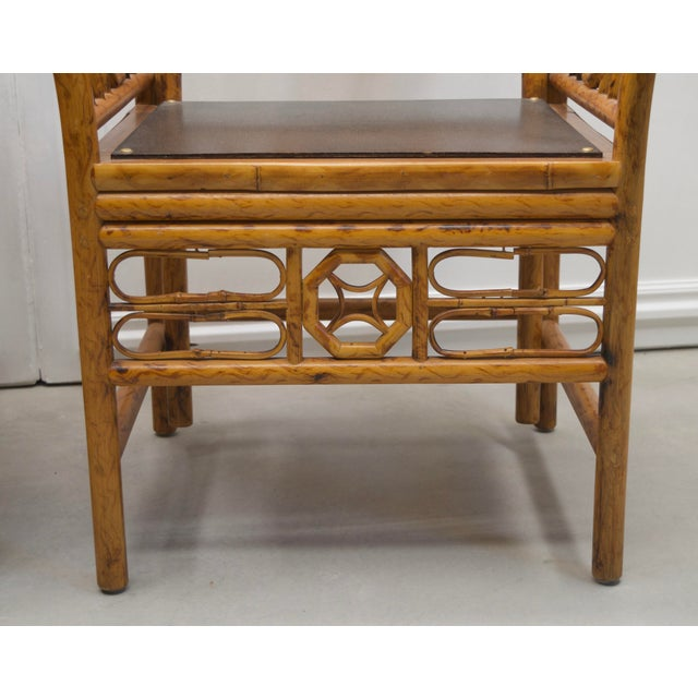 Elegant pair of vintage Maitland Smith tortoise bamboo chinoiserie chairs. Handmade in the Philippines by artisans....