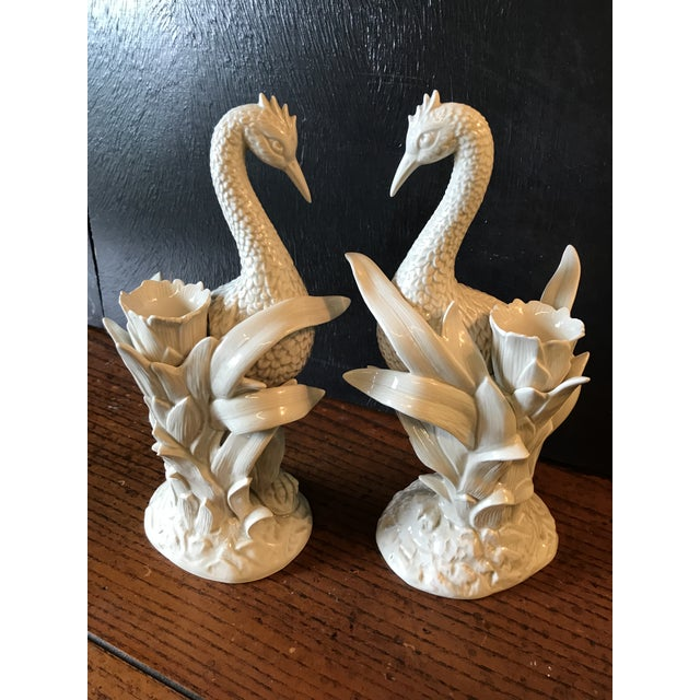 Lovely pair of vintage Fitz and Floyd heron and palm leaf candle holder. Almost perfect condition with the exception of a...