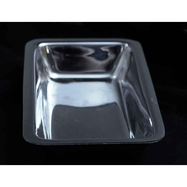 Stainless steel rectangle shaped tong rest or serving dish salvaged from the Waldorf Astoria in New York City. Made by...