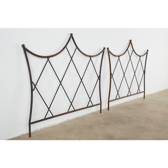 Dramatic midcentury pair of twin headboards made in the Regency taste. Features a handcrafted wrought iron frame with...