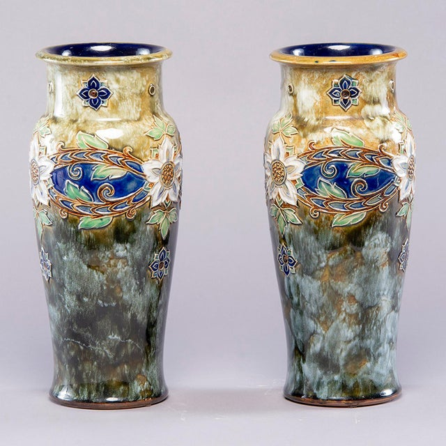 Circa 1920s pair tall Royal Doulton Lambeth vase by Winnie Bowstead. These large and striking pieces are decorated in the...