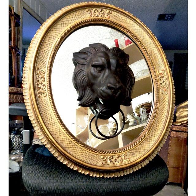 Lion Head Door Knocker Framed by a Vintage Golden Oval Mirror For Sale - Image 4 of 6