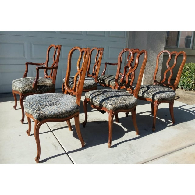 This wonderful set of six early 20th Century French carved chairs with cabriole legs and claw feet, features two Captain's...