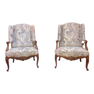 Early 19th Century French Walnut Wing Chairs - A Pair