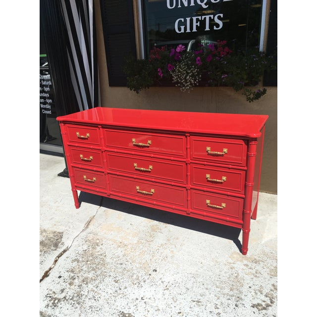 Stunning in Scarlet Red. A Vintage Henry Link 9-drawer faux bamboo dresser, from the Bali Hai collection.. Professionally...
