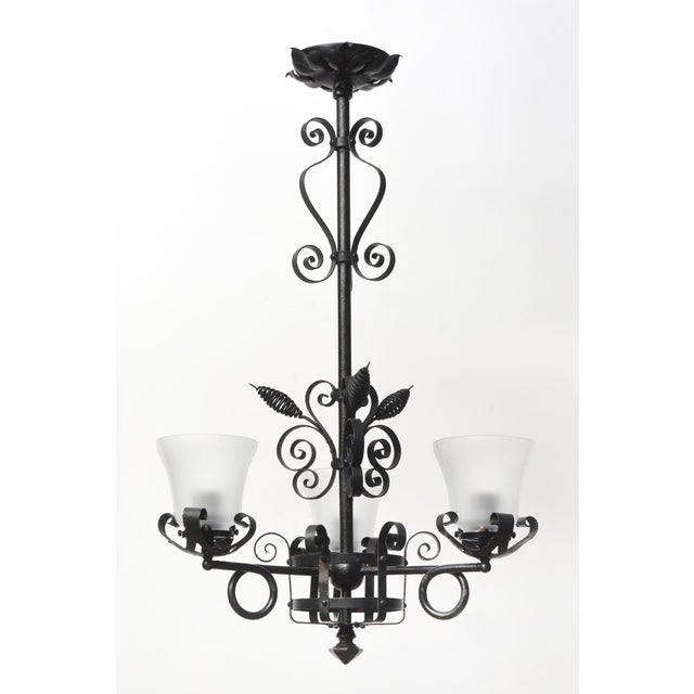 Three light fixture with wrought iron and new glass. Completely restored and rewired, ready to hang. C. 1900.