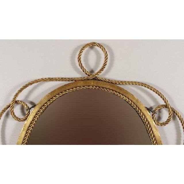 Attractive gilt metal tassel & rope mirror circa 1950. Elegant design in Jansen Parisian/ Hollywood Regency styles fine...