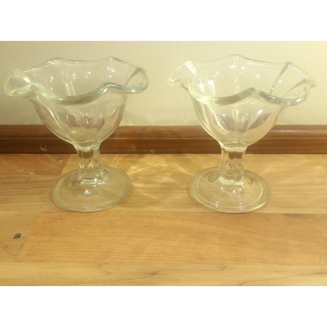 Pair of glass KIG Indonesia dessert dishes. Shaped like a flower and have a footed base.