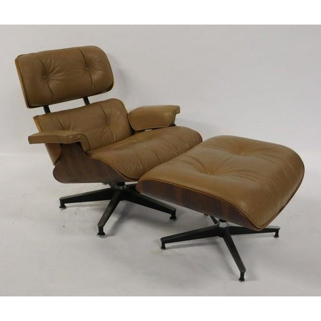 Charles Eames, Herman Miller Mid-Century Modern chair & ottoman. A stunning example of Eames Miller style and grace from...