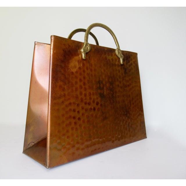 Vintage; Hollywood Regency hand forged, hammered copper magazine holder, with polished brass, tassel-rope motif,...