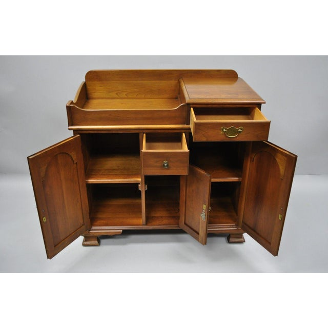 Rolling casters, solid wood construction, beautiful woodgrain, 3 swing doors, original stamp, 2 dovetailed drawers,...