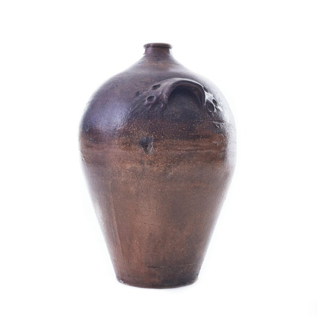 Large earthenware wine jug from the mid 19th century. Featuring a beautifully mottled salt fire finish and hand-applied...