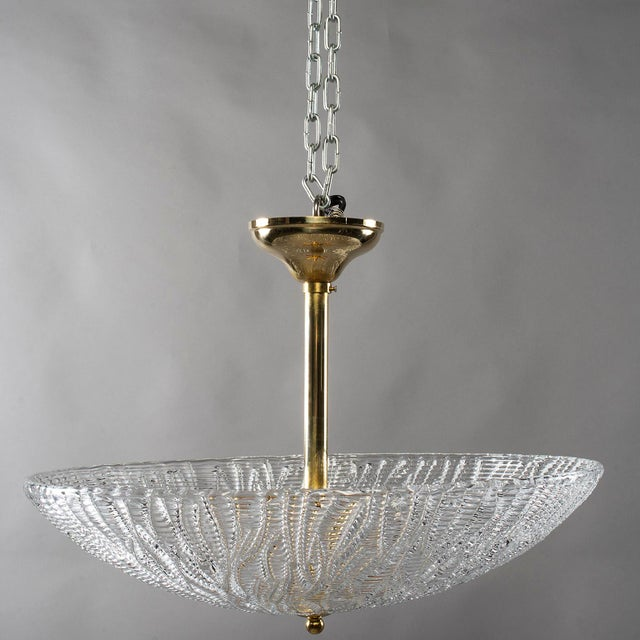 Circa 1960s ceiling / pendant fixture attributed to Barovier and Toso consists of thick, clear handblown glass with a...