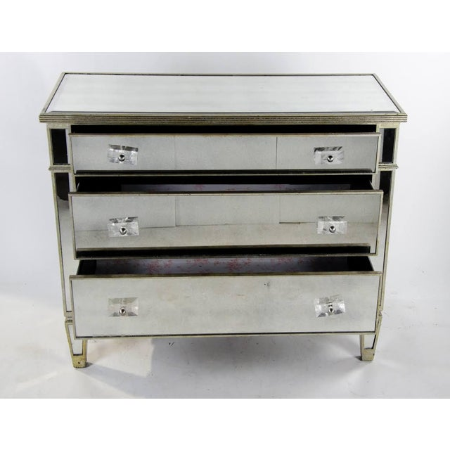 Make a statement as you add essential storage to your master suite with this glamorous French style mirrored commode. It...
