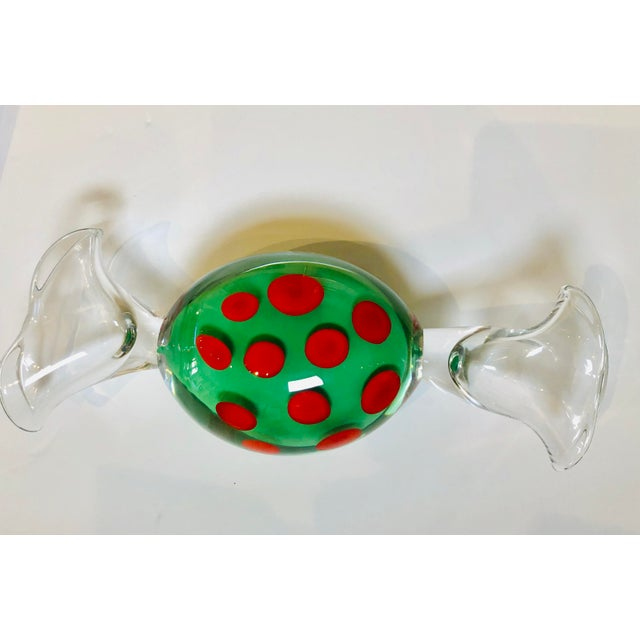 Handblown art glass candy with green and red dots, dated 1996 signed Studio Ahus Sweeden and number.