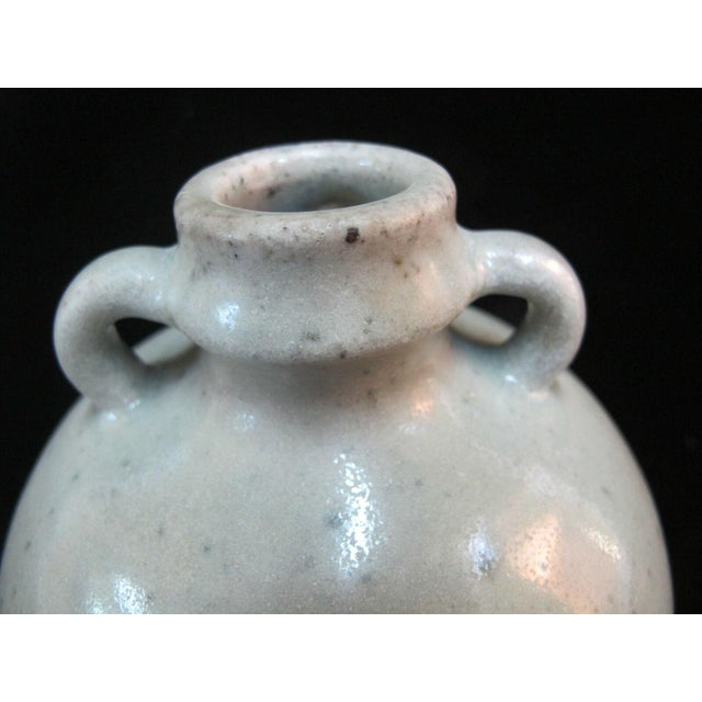 "Antique Celadon pot, globular in shape with 2 loop handles. Measures 6 1/2"" tall x 5"". Excellent condition, light nick in..."