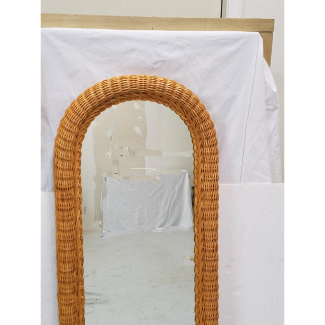Tall woven wicker wall mirror. Perfect scale for your entry, hallway or powder room. It is in great vintage condition,...