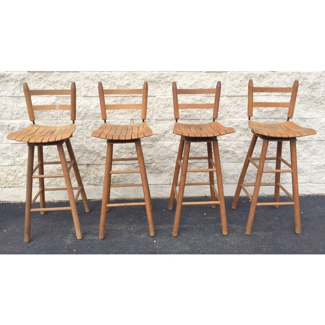 Offering a nice set of 4 Mid-Century Modern bar stools. They are like Arthur Umanoff for Raymor but are made out of wood....
