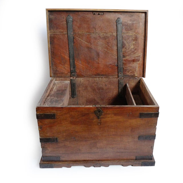 Antique Indian dowry trunk from Rajasthan. Solid old world construction with hand forged iron brackets and details....